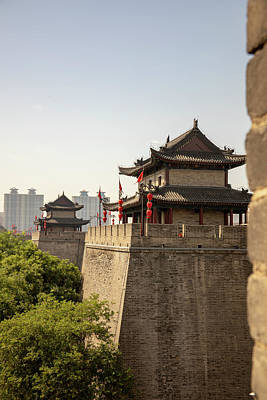 Popstar And Musician Paintings - Ancient city wall with pagodas against modern Xian, China by Karen Foley