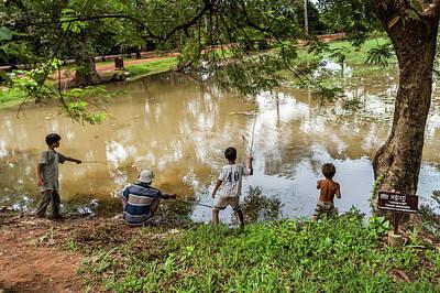 Photograph - Angkor Fishing Family by Ian Robert Knight