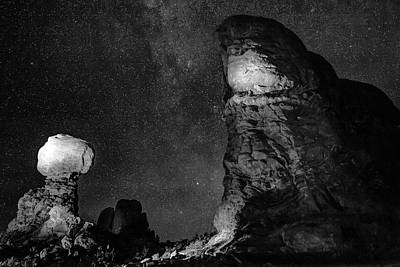 Photograph - Arches National Park Monoliths Under A Star Filled Night Sky - Monochrome by Gregory Ballos