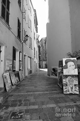 Photograph - Art in a small street by Tom Vandenhende