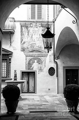 Photograph - Art In The Courtyard Florence by John Rizzuto