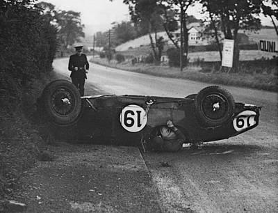 Photograph - Aston Martin Spill by Fox Photos