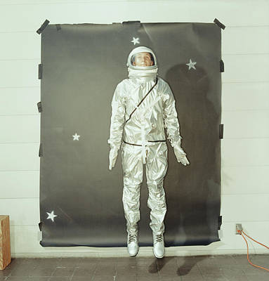 Photograph - Astronaut Jumping In Mid Air, Space by Michael Kelley