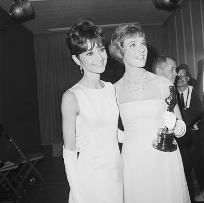 Holding Photograph - Audrey Hepburn And Julie Andrews With by Bettmann