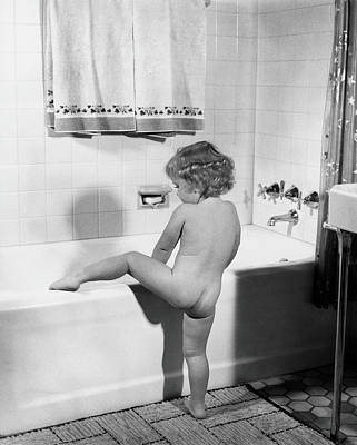 Indoors Photograph - Baby Girl Climbing Into Bath Tub by H. Armstrong Roberts