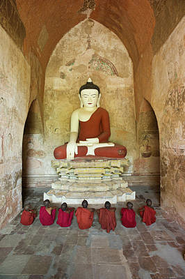 Traditional Clothing Photograph - Bagan, Buddhist Monks Sitting In Temple by Martin Puddy