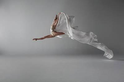 Photograph - Ballerina Performing A Grand Jeté by Nisian Hughes