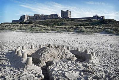 Photograph - Bamburgh Castle And Beach. by David Birchall