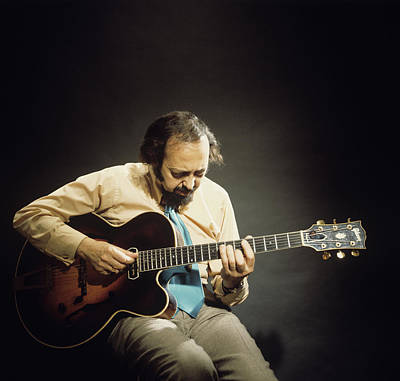 Photograph - Barney Kessel Performs On Stage by David Redfern