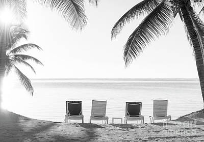 Photograph - Beach Holiday Deckchairs Black And White by Tim Hester