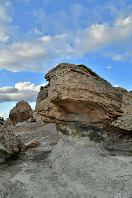 Photograph - Beautiful Clouds Over Bentonite Site Boulders by Ray Mathis