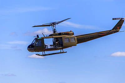 Photograph - Bell Uh-1 In Flight by Doug Camara