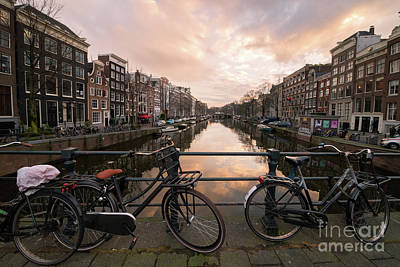 Photograph - Bicycles And Canal Houses In Amsterdam At Sunset by IPics Photography