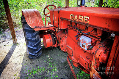 Photograph - Big Red Case Tractor At Boone Hall Plantation by John Rizzuto