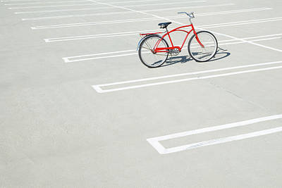 Bike In Empty Parking Lot Art Print by Peter Starman