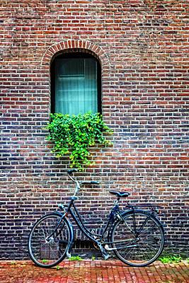 Photograph - Bike Under The Window by Debra and Dave Vanderlaan