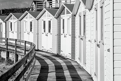 Photograph - Black And White Bude Beach Huts by Helen Northcott