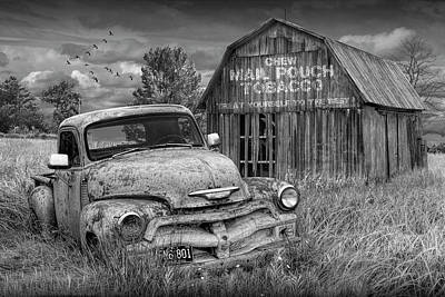 Randall Nyhof Royalty Free Images - Black and White of Rusted Chevy Pickup Truck in a Rural Landscape by a Mail Pouch Tobacco Barn Royalty-Free Image by Randall Nyhof