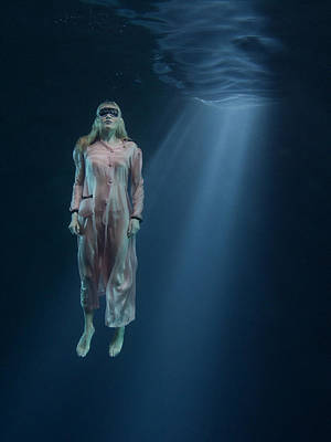 Photograph - Blindfolded Woman Floating In Water by Jfb