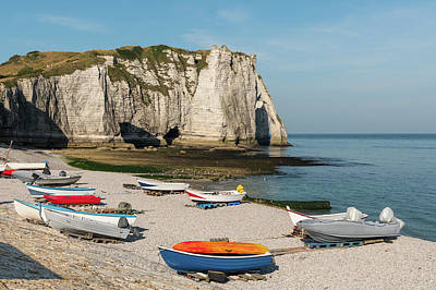 Food And Flowers Still Life Rights Managed Images - Boats in front of the halk cliffs of Etretat with the natural arch Porte dAval and the stone needle called LAiguille Royalty-Free Image by Stefan Rotter