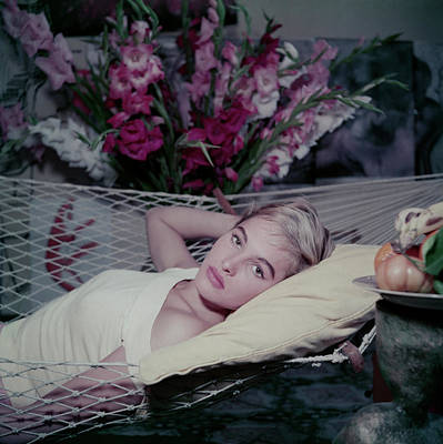 Lying Down Photograph - Bond Girl To Be by Slim Aarons