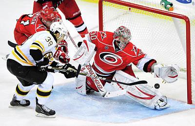Photograph - Boston Bruins V Carolina Hurricanes by Grant Halverson