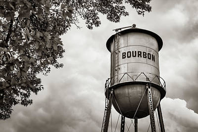 Photograph - Bourbon Whiskey Water Tower And Clouds - Classic Sepia Edition by Gregory Ballos