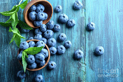 Gastronomy Photograph - Bowl Of Fresh Blueberries On Blue Rustic Wooden Table From Above by Jelena Jovanovic