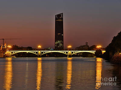Photograph - Bridge Over Guadalquivir River At Dusk by Angelo DeVal