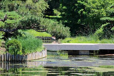 Bridge Over Pond In Japanese Garden Art Print