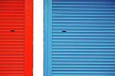 Photograph - Bright Red And Blue Roller Shutters by M. Ivkovic - Bangphoto.co.uk