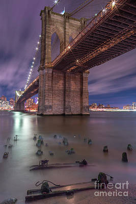 Photograph - Brooklyn Bridge From East River With Broken Pier On Foreground At Night With Long Exposure by Andriy Stefanyshyn