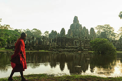 Photograph - Buddhist Monk By Temple And Lake by Cultura Rm Exclusive/stuart Westmorland