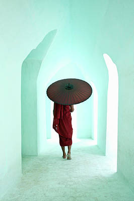Indoors Photograph - Buddhist Monk Walking Along Arched by Martin Puddy