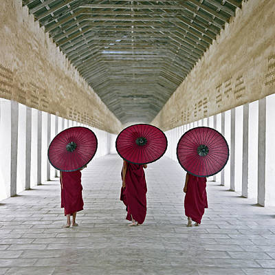 Photograph - Buddhist Monks Walking Along Temple by Martin Puddy