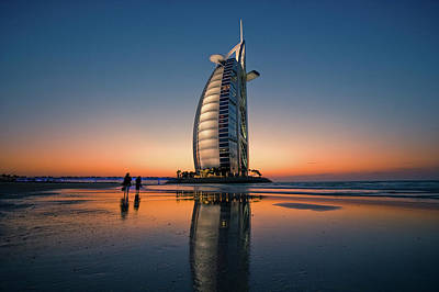 Photograph - Burj Al Arab Hotel Reflected On Beach by Merten Snijders