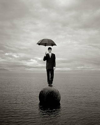 Photograph - Businessman Holding Umbrella by Chris Carlson
