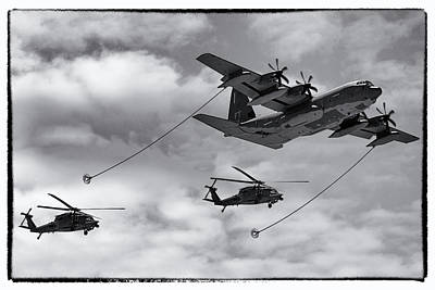 Photograph - C-130 Refuelling Blackhawks by Chris Smith