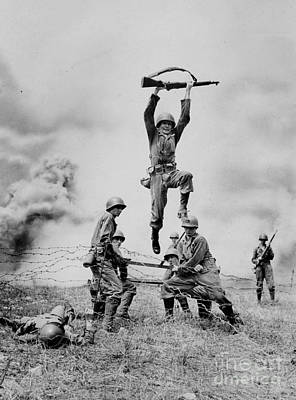Photograph - Cadet John L. Carr Jumping Over Barbed by New York Daily News Archive