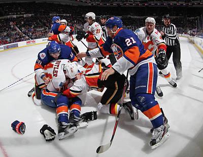 Photograph - Calgary Flames V New York Islanders by Bruce Bennett