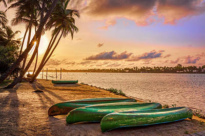 Photograph - Canoes At Sunrise by Debra and Dave Vanderlaan