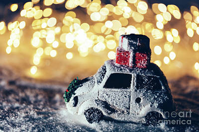 Photograph - Car With Christmas Gifts On The Roof On Snowy Road by Michal Bednarek