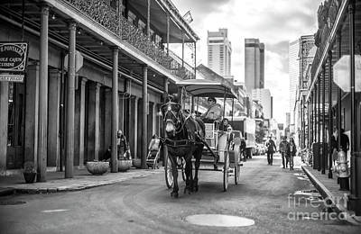 Photograph - Carriage On Chartres Street New Orleans by John Rizzuto