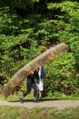 Photograph - Carrying A Camouflaged Canoe by Les Palenik
