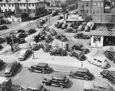 Photograph - Cars Surround One Gas Pump by Bettmann