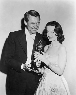 Photograph - Cary Grant & Jean Simmons At Oscars by American Stock Archive