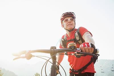 Caucasian Man Pushing Mountain Bike Art Print by Mike Kemp