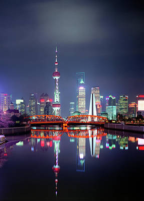 Photograph - China, Shanghai Skyline At Night by Martin Puddy