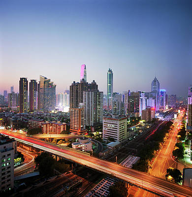 Photograph - China, Shenzen Skyline At Dusk by Martin Puddy