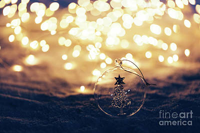 Photograph - Christmas Ornament On Snowy Illuminated Background. by Michal Bednarek